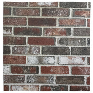 Multi color brick wall with reds, whites and brown napkin