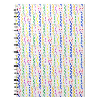 Multi Colored Party Streamers on White Notebooks