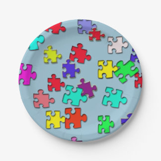 Multicolored jigsaw puzzles pieces paper plate