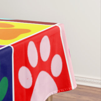 Multicolored Paws in Multicolored Squares Tablecloth