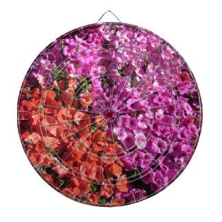 Multicolored petunia flowers texture background dartboard