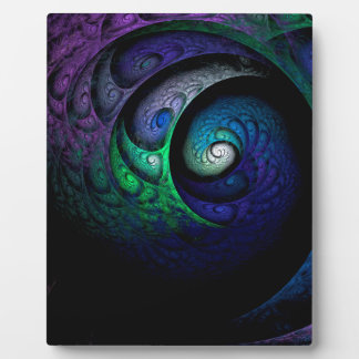 Multicolored spiral fractal picture on the dark plaque