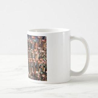 Multiple decorated flower vases coffee mugs