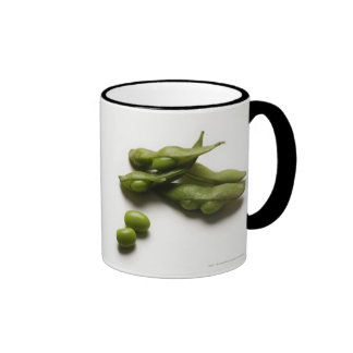multiple green edamame beans with pea pod broken coffee mug