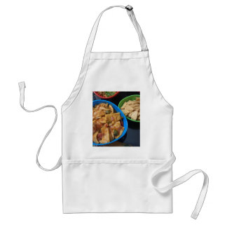 Multiple snacks ready for eating, in small plastic apron