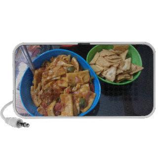 Multiple snacks ready for eating, in small plastic travelling speaker
