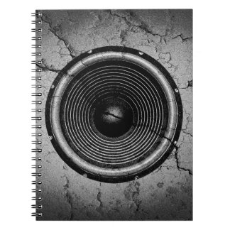 Music speaker on a cracked wall notebook