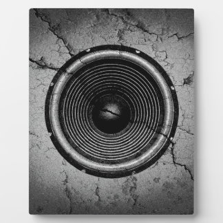 Music speaker on a cracked wall plaque
