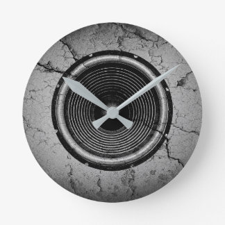 Music speaker on a cracked wall round clock