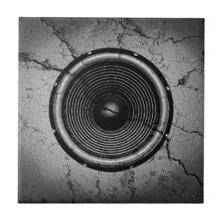 Music speaker on a cracked wall tile