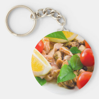 Mussels, squid and octopus, decorated with greens, key ring