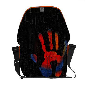 My hand with fire on wood commuter bags