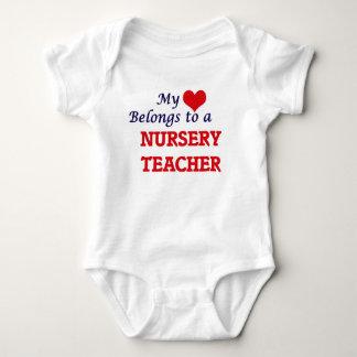 My heart belongs to a Nursery Teacher Baby Bodysuit