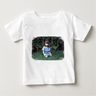 Mylune sitting in the grass baby T-Shirt