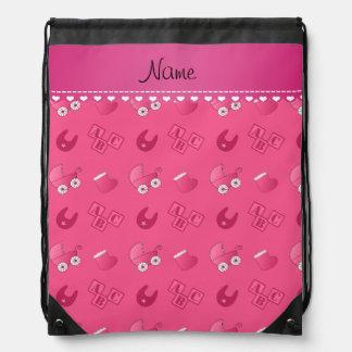 Name pink baby bib blocks carriage booties backpacks