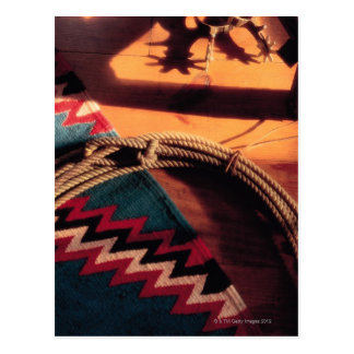 Native American blanket , lasso , and spurs Postcard