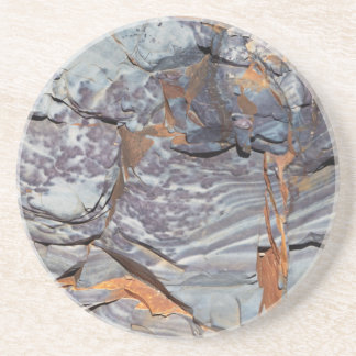 Natural layers of agate in a sandstone coaster