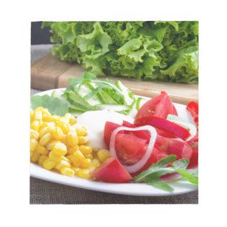 Natural salad of tomatoes, mozarella cheese notepad