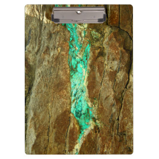 Natural turquoise vein in rough brown stone clipboard