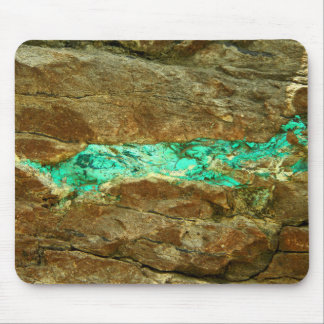 Natural turquoise vein in rough brown stone mouse pad