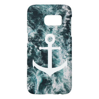 Nautical anchor on ocean photo background
