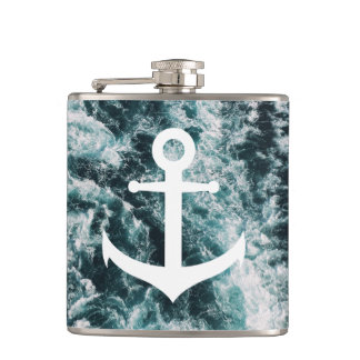 Nautical anchor on ocean photo background hip flask