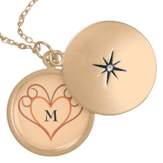 Necklace with heart ornament and monogram