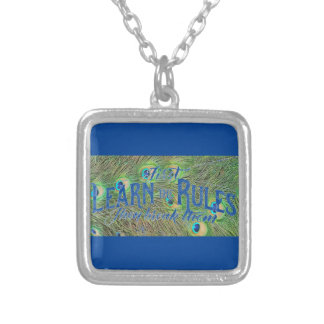 necklace with photo of peacock feathers & saying