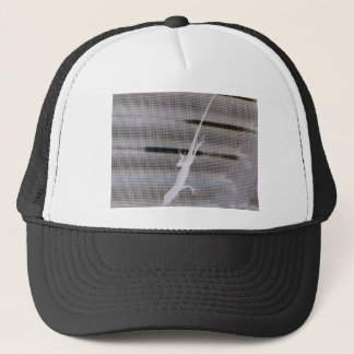 Negative image of a lizard on a window screen trucker hat