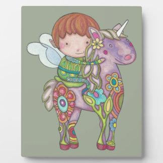 Nelf and its unicorn plaque