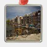 Netherlands, Amsterdam. View of canal from Silver-Colored Square Decoration