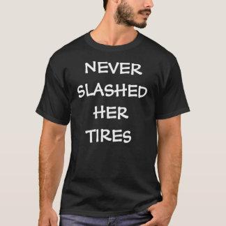NEVER SLASHED HER TIRES T-Shirt