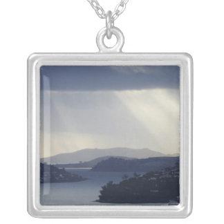 New Zealand, Otago, Dunedin, Light Shafts over Square Pendant Necklace