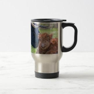 Newborn scottish highlander calf with mother cow travel mug