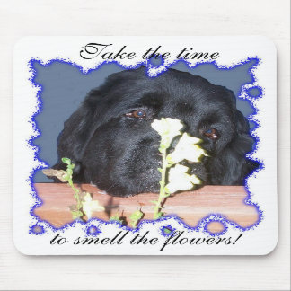 Newfoundland dog smell the flower mouse pad