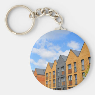 Newly built houses against blue sky basic round button key ring