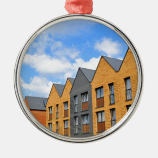 Newly built houses against blue sky Silver-Colored round decoration