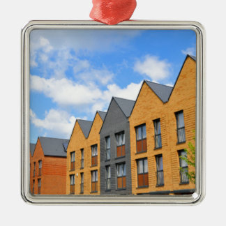 Newly built houses against blue sky Silver-Colored square decoration