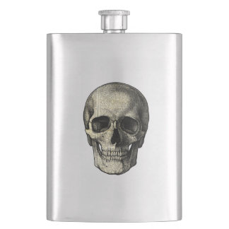 Newspaper skull hip flask