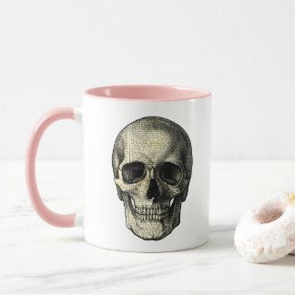 Newspaper skull mug