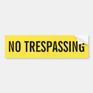 No trespassing yellow and black sticker