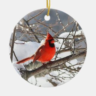 Northern cardinal in the snow ceramic ornament