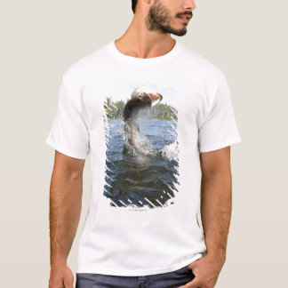 Northern Pike jumping out of water in a lake. T-Shirt
