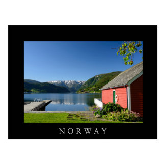 Norwegian fjord and boathouse black postcard