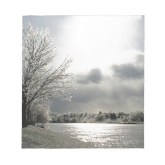 notepad with photo of icy winter landscape