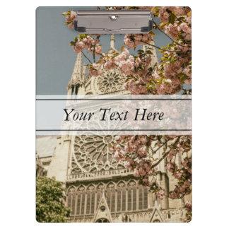 Notre Dame de Paris in Pink Spring Flowers Clipboard