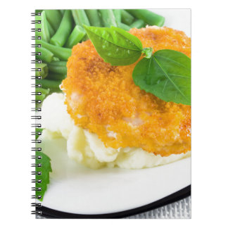 Nuggets of chicken, mashed potatoes and green bean notebooks