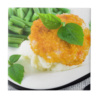 Nuggets of chicken, mashed potatoes and green bean tile