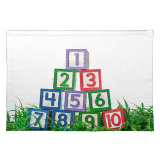Number blocks stacked on grass placemat