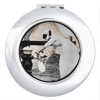 Nurse Pumping Water WWI Travel Mirrors